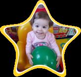 A little girl holding a ball