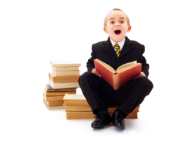 A boy sitting on the books