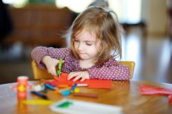 A girl cutting a paper