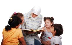 A teacher tells a story to her children