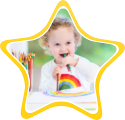 A toddler holding a pencil